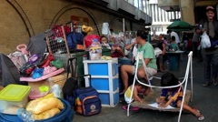 Street vendors sidewalk family dwellers Stock Footage