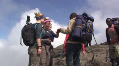 Stock Video Footage of People on the top of mountain are congratulating each other. Tanzania
