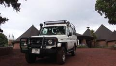 Jeep for safari passes by. Tanzania Stock Footage