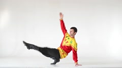 Young man wearing a folk costumes dancing on white in full length Stock Footage