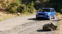 Blue Car Moving off with a Skid - stock footage