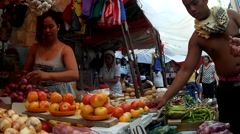 People on street occupied by fruit vendors Stock Footage