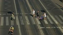 People crossing Solidarity street on a sunny day in Warsaw Stock Footage