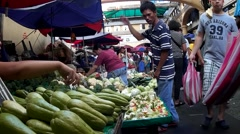 People on street occupied by vegetable vendors Stock Footage