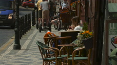 Girls relaxing at a small outdoor restaurant in Prague Stock Footage