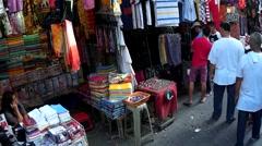 People walking street occupied by street vendors Stock Footage