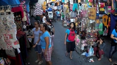 People on street occupied by accessory vendors - stock footage