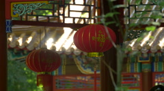 Red chinese lanterns decorating a pagoda pavilion in Warsaw Stock Footage