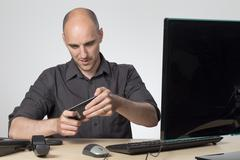 Playing games when he should be working - stock photo