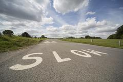 SLOW, UK road marking Stock Photos