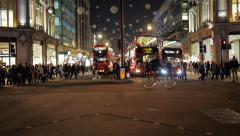 Buses and shoppers, Oxford Circus at night, London, UK Stock Footage