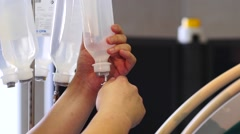 Closeup of hands changing drip during endoscopic surgery. Stock Footage