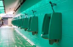 Men chamber pot automatic flush Stock Photos