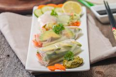 Spring rolls with vegetables and avocado Stock Photos