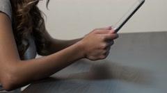 Hispanic woman uses tablet Stock Footage