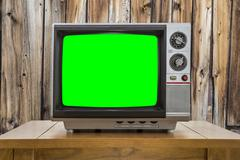 Vintage Portable Television with Chroma Green Screen and Rustic - stock photo