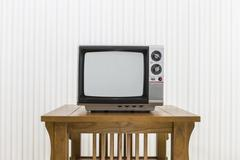 Old Portable Television on Wood Table - stock photo