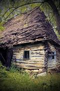 Stock Photo of abandoned old traditional romanian mountain house with vignette, vintage look