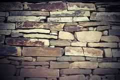 Vintage look of stone texture with vignette for your exterior architectural d Stock Photos