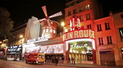 Illuminated sign over Moulin Rouge in Paris Stock Footage