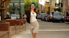 Cheerful fashion woman going crazy making funny face and dancing Stock Footage