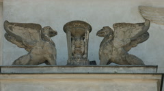 Small statues on a building in Warsaw Stock Footage