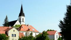 view of the small village in the countryside - church dominates - stock footage