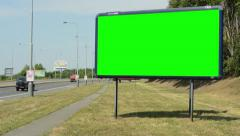 View of the advertising billboard near by the road - green screen Stock Footage