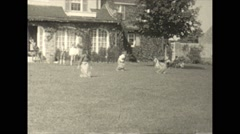 Vintage 16mm film, 1925, New Jersey, family gathering, children sack race Stock Footage