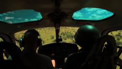 Rare shot inside Helicopter over Kruger National Park behind Pilot and Ranger Stock Footage