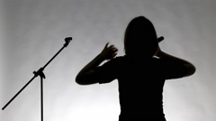 Silhouette of girl with microphne Stock Footage