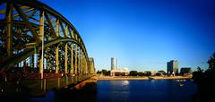 Europe Germany Cologne Köln Koln Koeln skyline Hohenzollern bridge at dusk - stock photo