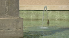 Water splashing from a fountain pipe in Warsaw Stock Footage