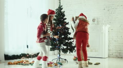 Children decorate the Christmas tree Stock Footage