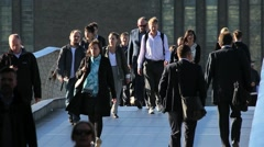 Hundreds Of Commuters Cross A Bridge In London To Work In The City Stock Footage