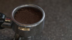 A tamper compacts coffee grounds Stock Footage