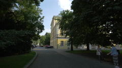 Cars parked near Zofin Palace in Prague Stock Footage