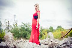 The blonde in a red dress, loose material, fashion - stock photo