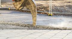 Excavator Ripping Asphalt - stock photo