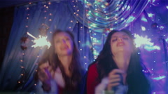 Two girls dancing with Christmas lights - stock footage