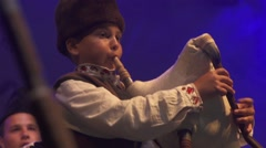 Boy playing the bagpipes of Bulgarian Folklore Festival Stock Footage