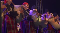 Men and women playing the bagpipes of Bulgarian Folklore Festival Stock Footage