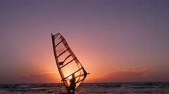 Windsurfing. Man preparing to put to sea. Stock Footage