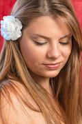 Girl with flower in haire Stock Photos