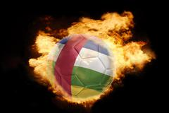 Football ball with the flag of central african republic on fire Stock Photos