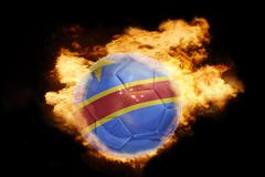 Stock Photo of football ball with the flag of democratic republic of the congo on fire