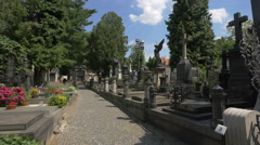Stock Video Footage of Cobblestone alley between the Vyšehrad cemetery's tombstones in Prague