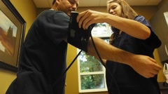 Student nurse learning blood pressure cuff - stock footage