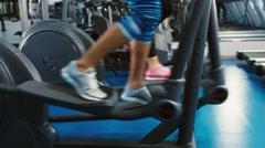 Legs work on elliptical trainer Stock Footage