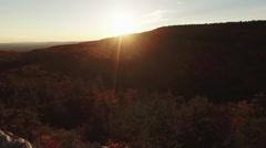 Incredible aerial of hiker reaching peak at sunset Stock Footage